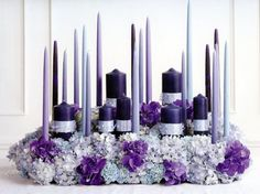 Purple and Silver Candles and Flowers Centerpiece