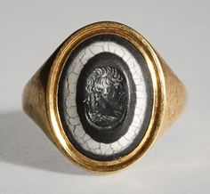 Portrait of Antinous. Roman ringstone, 2nd century  Onyx, gold (modern gold ring). 1,5 x 1,2 cm Inventory number: I1008