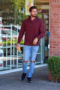 Scott Disick wearing Ksubi Van Winkle Jeans in Non Cents, Adidas Ultra Boost in Black and John Elliott Hooded Villain Hoodie in