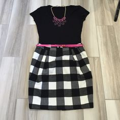"""Adorable Checkered Style Skirt with pink belt Super cute skirt 65% Polyester 35% Rayon. Front pockets. Very flattering cut! Top waistband to bottom seam 19"""". Brand New never worn. Ref#X0830 She said... Skirts"""