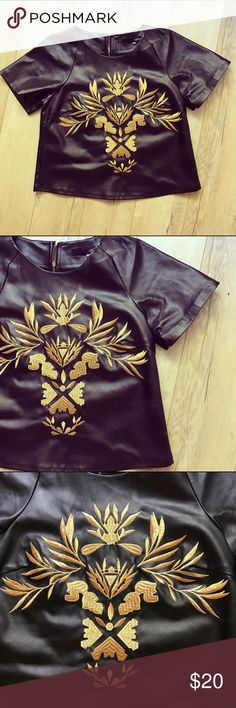 Faux leather top Gold embroidered faux leather black top. It's a little bit boxy that's why I purchased the xs. The texture is unbelievable it uplifts any outfit. As new condition, embroidery intact 👌🏽 Tops Crop Tops