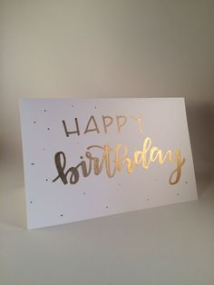 Happy Birthday hand-lettered birthday card. Hand-lettered card written with acrylic paint pen. Ink color: Shiny gold. Inside is blank. 5 1/2 x 8