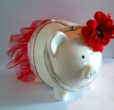 Check out this item in my Etsy shop https://www.etsy.com/listing/246829749/tutu-piggy-bankwith-pearls-and-flower