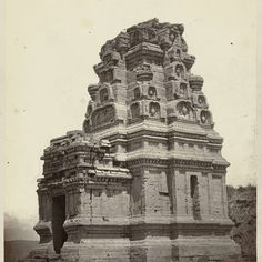 Candi Bhima, general view including its superstructure with sculpted heads and entrance. Dieng plateau, Wonosobo district, Central Java province, 9th century, Isidore van Kinsbergen, 1864 - Rijksmuseum