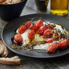 A classically perfect little dish - labneh with roasted tomatoes on the vine & za'atar