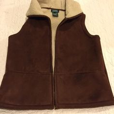 Laurent Ralph Laurent faux shearling hooded vest Warm and cozy full zip vest in faux- shearling interior with a softly suede look exterior, has two front pockets. Excellent condition. Looks great with leggins and suede boots. Ralph Lauren Jackets & Coats Vests