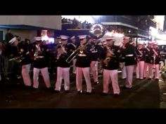 Marines at Mardi Gras, tearing it up! Their brand of jazz rivals the regulars down in the French Quarter, and the crowd is eating it up. By the looks of things, no one wants the music to end.