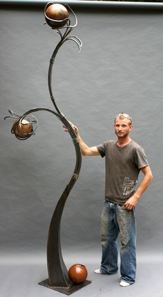 "Large abstract forged steel sculpture for C&C Golden Harvest, Steel, found, copper leaf, 9' 6"" Artwork - Imgur. Make the balls lamps!"