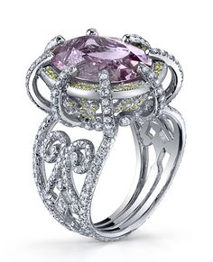 Classical  Erica Courtney, Erica Courtney: Platinum ring featuring an 11.19 ct. Imperial pink Topaz accentedwith Diamonds.