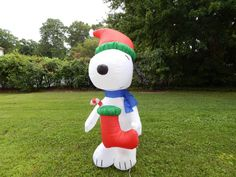 Snoopy Holding Boot Christmas Inflatable.  This adorable 6 foot Snoopy is ready to celebrate Christmas as he has his large red boot with him and is ready to bring Christmas cheer to your yard this year.