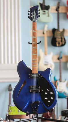 One of the most iconic staples in the company's roster, the Rickenbacker 360 Electric Guitar stands in celebrity alongside the likes of the Stratocaster and Rickenbacker Guitar, Ezra Koenig, Guitar Chord Progressions, Guitar Photos, Blue Black Color, Vampire Weekend, Beautiful Guitars, Custom Guitars, Electric Guitars