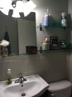Very small bathroom- making space, shelving from Ikea.