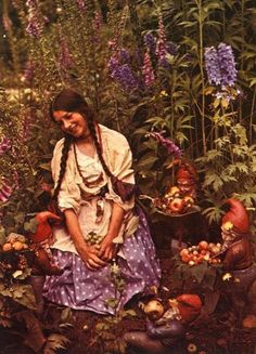 Antique autochrome photo of a beautiful young woman in a flower garden. Dreamy :)