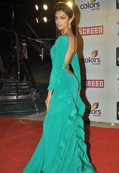 Deepika Padukone in a green gown with a dangerously low plunge at the back. #Bollywood #Fashion