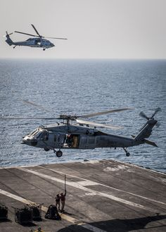 ARABIAN GULF (March 4, 2015) An MH-60S Sea Hawk helicopter from the Red Lions of Helicopter Sea Combat Squadron (HSC) 15 hoovers over the flight deck of the aircraft carrier USS Carl Vinson (CVN 70) as Sailors aoperations in Iraq and Syria as directed, and theater security cooperation efforts in the U.S. 5th Fleet area of responsibility.  (U.S. Navy photo by Mass Communication Specialist Seaman D'Andre L. Roden/Released)