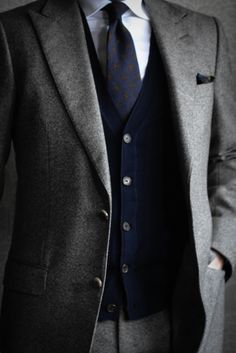 Tweed.  Ohhhh.....it takes a very special man to carry off a look like this. Such wonderful quiet restraint.  I did a double take with the buttoned sweater vest, like my Grampy used to wear.  Warm and fuzzy and comforting but this look is more formal. Great look!