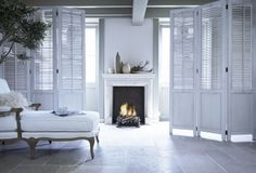 #fireplace #annekedekkers #fire #gezellig #classic #chic #accessoires #living #interior #mirror #floor #stone #lamp #antique #vintage #white #clean #sofa #roomdivider
