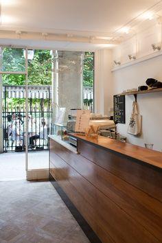 Dark wood running along the perimeter / Café Kitsune / Best Coffee Shops in Paris / Trottermag