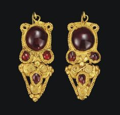 A Pair of Roman Gold and Garnet Earrings – circa 2nd century AD Each with a hoop of two spiral-twisted wires merging into a single earwire, ...