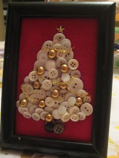 White button Christmas tree with gold chain garland in black frame~