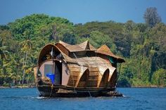 Traditional houseboat floating down the backwaters of Kerala, India | Visit kerala in your budget | Key word : Hot Tour india, Trip india, holiday package india, tourism india, tourist place india, know about indian culture