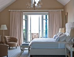 A cathedral ceiling and calm neutrals make the master bedroom a sensuous, soothing retreat. Walls are Sand Dunes by Benjamin Moore.