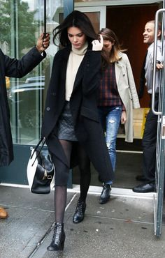 Reality star turned mondel Kendall Jenner is seen stepping out on a rainy day in New York City, New York on October 23, 2014. Kendall had someone carry her umbrella for her to hide from the rain.