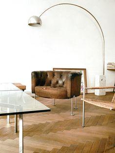 Herringbone parquet flooring, leather armchair and arc lamp, super cool combo