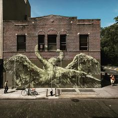 Faith47 amazing wall with mysterious swans dancing! This is in New York. Faith47's debut solo show in New York City is on at Jonathan Levine Gallery until 19 December 2015. #faith47 #isupportstreetart #streetart #walls #photooftheday #animals