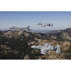 An F-15 Eagle and two A-10 Thunderbolts in flight over Central Idaho Canvas Art - High-G ProductionsStocktrek Images (35 x 24)
