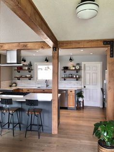 In this remodeled home, classic lighting styles were used as complements to the house's exposed fir timber beams, new floors, and other modern features. Home Decor Kitchen, Kitchen Interior, Home Kitchens, Living Room Kitchen, Home Renovation, Home Remodeling, Küchen Design, House Design, Kitchen Layout
