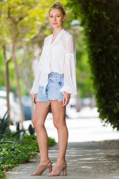 "Cut-Off Jean Shorts - ""I wear these slouchy shorts so much I'm bordering on never-nude status. For a summer evening I dress them up with a diaphanous top and neutral sandals.""Nicky Deam, Fashion Director"