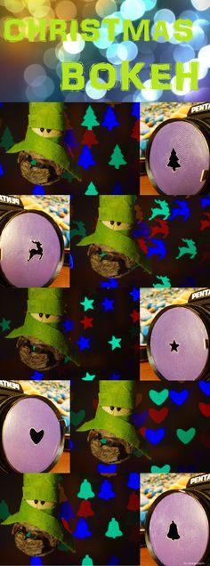 Christmas bokeh. Christmas tree, stars, reindeer, heart and bells bokeh with green claus.