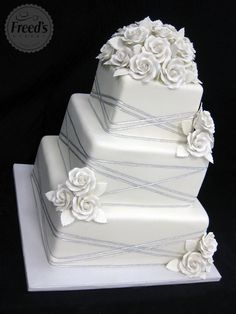 I really really really like this except with blue flowers instead of the white and then my topper with only a few roses on top!