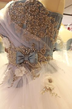 A Cinderella-like ball gown with blue corset covered in beaded embroidery. Would look pretty with some seed pearls added