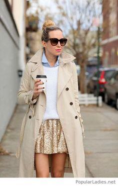 Gold glitter mini skirt, blue shirt, white sweater and a coat
