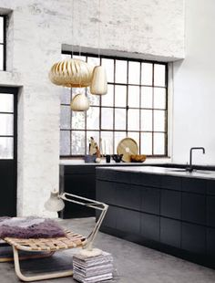 This is one handsome bathroom. The black tile's sleek sophistication balances the rough concrete and the wood tones add natural Nordic warmth.