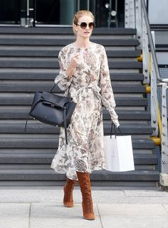 Rosie Huntington-Whiteley in a chiffon printed tie-waist dress and lace-up over the knee boots