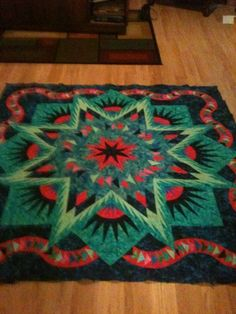 Glacier Star - a Judy Niemeyer pattern -- This one done in greens and reds. Striking!