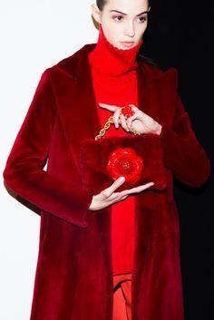 Oscar de la Renta Fall 2017 Rainbow Eye Makeup Beauty Look: Joie de vivre, or the enjoyment of life, was the theme behind Oscar de la Renta's fall 2017 beauty.-- Burgundy fur jacket and purse with red flower.   Coveteur.com