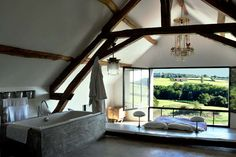 my dream bedroom/bathroom with a stunning view over hills :)