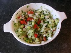 1/2 large white onion, diced  2 inch piece of cucumber, peeled, seeded and diced 4 ripe cherry tomatoes, diced 3 tbsp finely chopped coriander (leaves and stems) 2 tbsp finely chopped fresh mint (just leaves) Juice of ½ a lemon Salt, pepper and sugar to taste