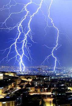 Lightnings brighten the sky over Ankara the Turkish capital on June 15, 2014. Following a waterspout... - Getty Images/Getty Images