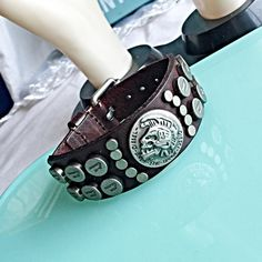 """NEW DIESEL BRWN LEATHER SILVER STUDDED UNISEX CUFF New! This diesel bracelet features a thick brown leather strap set with a stainless steel textured diesel logo. Material: Genuine Leather Closure: Buckle Measurements: 7 3/4 - 9 1/4"""" adjustable Gender: Unisex NO TRADES ❌QUESTIONS FROM NON SERIOUS BUYERS DO NOT BUNDLE UNLESS YOU INTEND TO BUY ✂️DO NOT LOWBALL ⛔️NO PRICE COMMENTS ⁉️PRICE IS FIRM AND REFLECTED ON FEES AND OUT OF POCKET COSTS Diesel Jewelry Bracelets"""