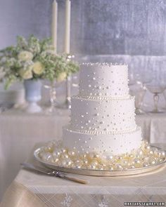 A simple cake frosted with white buttercream and blown-sugar Champagne bubbles