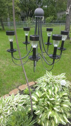 Repurposed a chandelier from a thrift shop into a outdoor solar light chandelier. Hangs beautifully off of a shepherds hook!