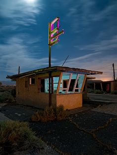 Snack Bar ... The take-away window at an abandoned diner on the west side of Yermo, California, a little community out in the Mojave Desert that's as much ghost town as it is anything else.  Shot in June 2011.