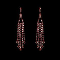 "Perfectly charming, these sparkling silver plated earrings feature dangling rows of red rhinestones. A beautiful choice for your wedding, prom, or special event.   ​The earrings fall to a romantic 3-1/2"" long."