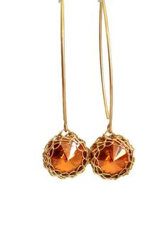 Delicate and bold, these Swarovski earrings display a polished broun cabochon in a dainty 14K gold-filled setting.  Clean and elegant