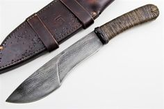 """Maker: Rick Marchand Blade Materials: 1095 Blade Length: 8.125"""" Handle Materials: Epoxy-Soaked Hemp-Wrap over Leather Overall Length: 13.375"""""""